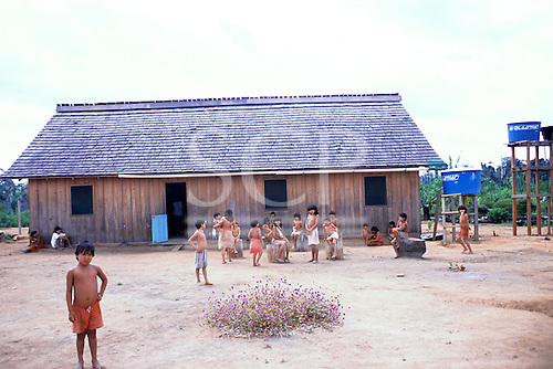Ipixuna village, Amazon, Brazil. Arawete girls and boys gather round the new health post.
