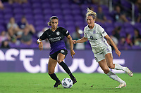 ORLANDO, FL - SEPTEMBER 11: Marta #10 of the Orlando Pride and Kaleigh Riehl #18 of Racing Louisville FC battle for the ball during a game between Racing Louisville FC and Orlando Pride at Exploria Stadium on September 11, 2021 in Orlando, Florida.