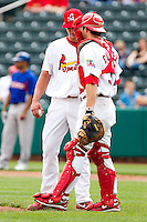Charles Cutler (37) of the Springfield Cardinals talks with Kevin Thomas (35) during a game against the Midland RockHounds on April 19, 2011 at Hammons Field in Springfield, Missouri.  Photo By David Welker/Four Seam Images