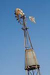 Rusting Aermotor windmill with metal tower tank.