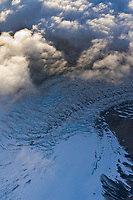 Aerial of clouds over the Muldrow glacier winding out from Denali, North America's tallest peak.