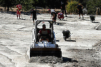 """Pictured: A small digger in the field where a search is ongoing in Kos, Greece. Thursday 29 September 2016<br /> Re: Police teams searching for missing toddler Ben Needham on the Greek island of Kos have said they are """"optimistic"""" about new excavation work.<br /> Ben, from Sheffield, was 21 months old when he disappeared on 24 July 1991 during a family holiday.<br /> Digging has begun at a new site after a fresh line of inquiry suggested he could have been crushed by a digger.<br /> South Yorkshire Police (SYP) said it continued to keep an """"open mind"""" about what happened to Ben."""