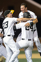 Drew Loepprich (23) and Keegan Maronpot (13) of the Wake Forest Demon Deacons jump on teammate Gavin Sheets (24) following his game winning hit in the bottom of the 9th inning against the West Virginia Mountaineers in Game Four of the Winston-Salem Regional in the 2017 College World Series at David F. Couch Ballpark on June 3, 2017 in Winston-Salem, North Carolina.  The Demon Deacons walked-off the Mountaineers 4-3.  (Brian Westerholt/Four Seam Images)