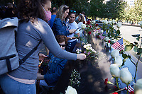 Flowers and wreaths commemorate the terror attacks of 9/11 at the National September 11 Memorial on the 20th anniversary of the September 11, 2001 terrorist attack on the World Trade Center and the Pentagon in New York, New York, on Saturday, September 11, 2021.<br /> CAP/MPI/RS<br /> ©RS/MPI/Capital Pictures
