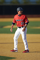 Liberty Flames head coach Scott Jackson (15) argues a call at first base during the game against the Wake Forest Demon Deacons at David F. Couch Ballpark on April 25, 2018 in  Winston-Salem, North Carolina.  The Demon Deacons defeated the Flames 8-7.  (Brian Westerholt/Four Seam Images)