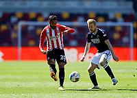 17th April 2021; Brentford Community Stadium, London, England; English Football League Championship Football, Brentford FC versus Millwall; Saman Ghoddos of Brentford passing the ball into midfield as Billy Mitchell of Millwall closes