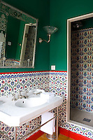 This elaborately tiled shower room has a distinctly Moroccan style