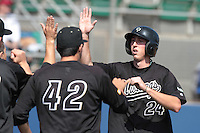 Tim Wise #24 of the Cal Poly Mustangs is greeted by teammates after scoring against the Loyola Marymount Lions at Page Stadium on February 25, 2012 in Los Angeles,California. Cal Poly defeated LMU 12-5.(Larry Goren/Four Seam Images)