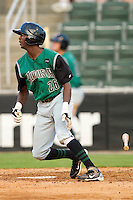 Evan Crawford #26 of the Augusta GreenJackets follows through on his swing against the Kannapolis Intimidators at Fieldcrest Cannon Stadium June 24, 2010, in Kannapolis, North Carolina.  Photo by Brian Westerholt / Four Seam Images