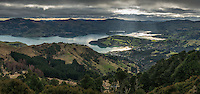 Moody skies over Akaroa township and harbour, Banks Peninsula, Canterbury, South Island, New Zealand