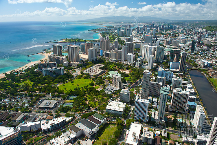 Aerial view from Waikiki overlooking Ft DeRussey, the Ala Wai Canal, and Magic Island looking towards downtown and the Waianae Mts