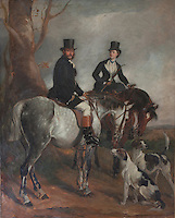 Portrait of a Victorian couple with their hunting hounds