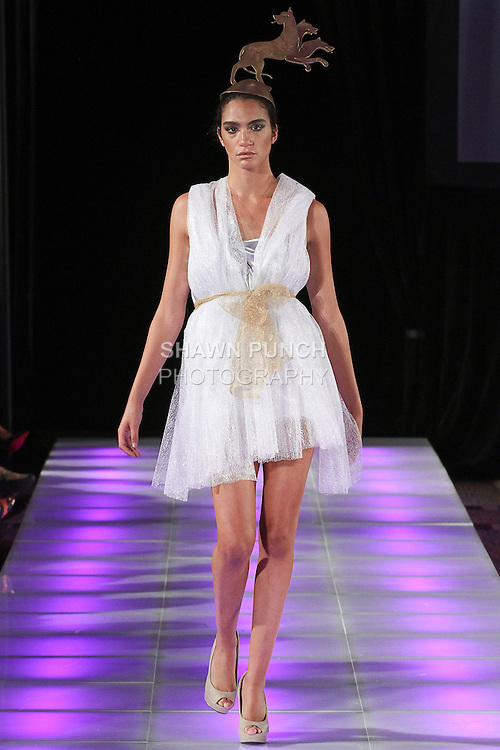 Model walks runway in an outfit from the Andres Aquino Spring Summer 2015 collection with 3-D printed hat by 3D-Store NYC, during Couture Fashion Week Spring 2015, in New York City.