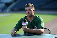 Fort Wayne TinCaps pitcher Joe Church (25) poses for a photo at the ESPN 100.9 desk before a game against the Great Lakes Loons on August 19, 2013 at Dow Diamond in Midland, Michigan.  Great Lakes defeated Fort Wayne 12-5.  (Mike Janes/Four Seam Images)
