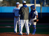 IMG Academy Ascenders pitching coach Ted Power talks with pitcher Keegan Allen (1) and catcher Will King (5) during a game against the Victory Charter School Knights on February 28, 2020 at IMG Academy in Bradenton, Florida.  (Mike Janes/Four Seam Images)