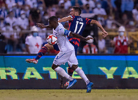 SAN PEDRO SULA, HONDURAS - SEPTEMBER 8: Maynor Figueroa #3 of Honduras fights for the ball with Sebastian Lletget #17 of the United States during a game between Honduras and USMNT at Estadio Olímpico Metropolitano on September 8, 2021 in San Pedro Sula, Honduras.