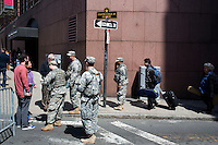 National Guard members check IDs and control access to the area streets near the site of the bombings in Boston, Mass., on April 16, 2013, the day after bombings at the Boston Marathon.  The cups are given to marathon runners during the race.
