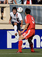 Sacha Kljestan kicks as China's Sun Xiang closes. The USA defeated China, 4-1, in an international friendly at Spartan Stadium, San Jose, CA on June 2, 2007.