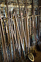 Garden tools stored in potting shed, Heligan, Cornwall.