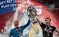 Northampton Town manager Keith Curle & Charlie Goode of Northampton Town lift the winning trophy during the Sky Bet League 2 PLAY-OFF Final match between Exeter City and Northampton Town at Wembley Stadium, London, England on 29 June 2020. Photo by Andy Rowland.