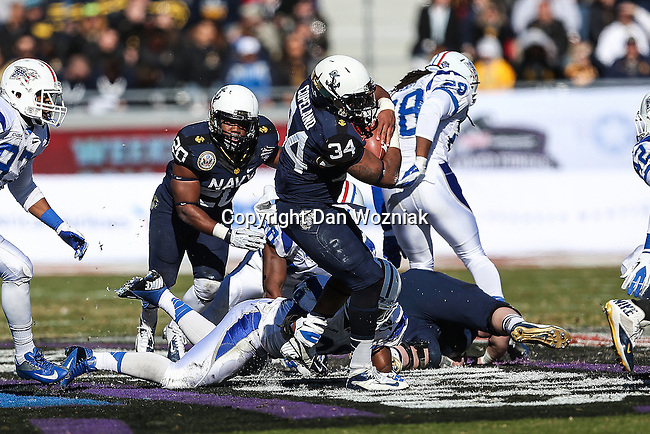 Navy Midshipmen fullback Noah Copeland (34) in action during the Armed Forces Bowl game between the Middle Tennessee Blue Raiders and the Navy Midshipmen at the Amon G. Carter Stadium in Fort Worth, Texas. Navy defeated Middle Tennessee 24 to 6.