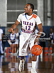 Texas-Arlington Mavericks guard Shaquille White-Miller (12) in action during the game between the McNeese State Cowboys and the UTA Mavericks held at the University of Texas at Arlington's, Texas Hall, in Arlington, Texas.  McNeese State defeats UTA 81 to 72.