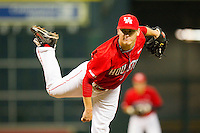 Starting pitcher Chase Wellbrock #15 of the Houston Cougars follows through on his delivery against the Texas A&M Aggies at Minute Maid Park on March 6, 2011 in Houston, Texas.  Photo by Brian Westerholt / Four Seam Images