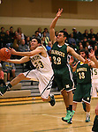 Manogue's James Sandoval drives past Alumni defender Davis Francis during the alumni game at the Wild West Shootout at Bishop Manogue High School in Reno, Nev., on Wednesday, Dec. 4, 2013. The Miners defeated the alumni 79-62. <br /> Photo by Cathleen Allison