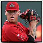 Starting pitcher Johnathan Diaz (31) of the Greenville Drive sets up to deliver a pitch in a game against the Greensboro Grasshoppers on Friday, August 17, 2018, at Fluor Field at the West End in Greenville, South Carolina. Greenville won, 4-1, and Diaz earned the win with eight strikeouts over seven innings. (Tom Priddy/Four Seam Images)