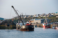 Dredger working in the harbour at Padstow, Cornwall