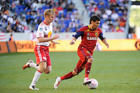 Javier Morales (11) of Real Salt Lake is chased by Tim Ream (5) of the New York Red Bulls. The New York Red Bulls and Real Salt Lake played to a 0-0 tie during a Major League Soccer (MLS) match at Red Bull Arena in Harrison, NJ, on October 09, 2010.
