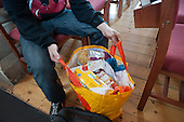 A client prepares to leave Norwood foodbank with enough food for his family for three days. The foodbank operates under the umbrella of the Trussell Trust, a Christian charity.