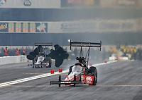 Feb 9, 2014; Pomona, CA, USA; NHRA top fuel dragster driver David Grubnic gets sideways in the shutdown area during the Winternationals at Auto Club Raceway at Pomona. Mandatory Credit: Mark J. Rebilas-