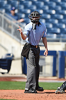Home plate umpire Travis Eggert makes a call during the first game of a doubleheader between the Frisco Rough Riders and Tulsa Drillers on May 29, 2014 at ONEOK Field in Tulsa, Oklahoma.  Frisco defeated Tulsa 13-4.  (Mike Janes/Four Seam Images)