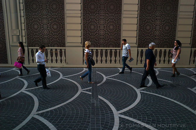 Pedestrians walk in front of a false wall covering which masks construction on Nizami street in Baku, Azerbaijan. With a huge influx in oil money, the urban landscape of Baku is rapidly changing from its dingy Soviet past.
