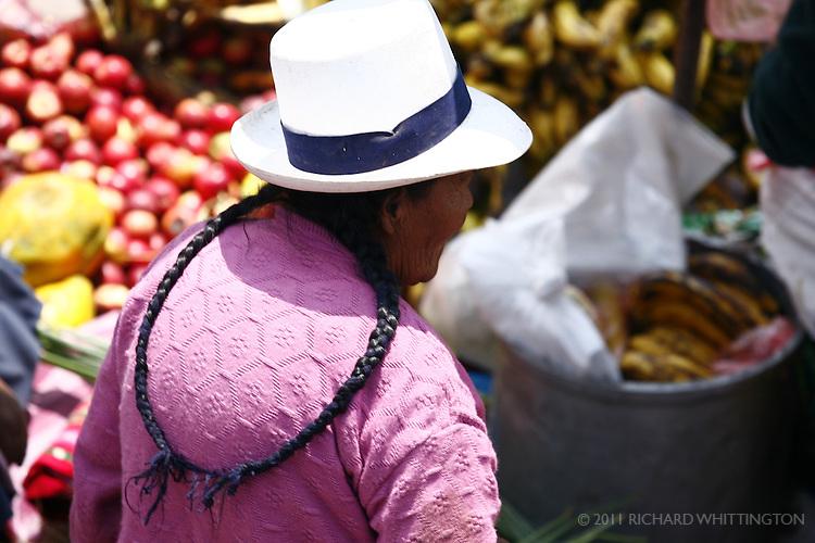 A Peruvian woman at the Pisac market.
