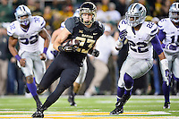Baylor inside receiver Clay Fuller (23) rushes with the ball during an NCAA football game, Saturday, December 06, 2014 in Waco, Tex. (Mo Khursheed/TFV Media via AP Images)