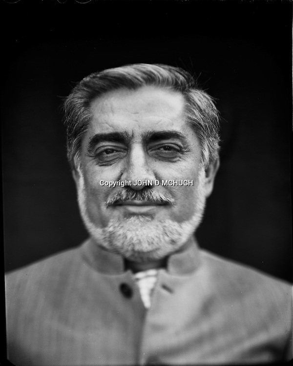 """Dr. Abdullah Abdullah, politician and runner up in last Afghanistan Presidential election, is seen in his rose garden in Kabul, 27 August 2012. This portrait was shot on a 5x4 Linhof Technika IV, circa 1959, and a Schneider Kreuznach 270mm lens, circa 1952, with front tilt, and is part of a series entitled """"Putting an Afghan face on the war."""" (John D McHugh)"""