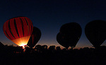 """*DIGICAM*.Ballonists conducts a """"balloon  glow"""" at sunset during the 13th Annual Highland Village Balloon Festival presented by the Highland Village Lions Club on Friday August 20, 1999 at Copperas Branch Park..Star-Telegram/Khampha Bouaphanh"""