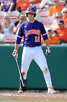 First Baseman Jon McGibbon #12 looks for signals during a  game against the Miami Hurricanes at Doug Kingsmore Stadium on March 31, 2012 in Clemson, South Carolina. The Tigers won the game 3-1. (Tony Farlow/Four Seam Images).