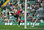 Celtic v St Johnstone...21.09.13      SPFL<br /> Liam Caddis scores despite the best efforts of Efe Ambrose<br /> Picture by Graeme Hart.<br /> Copyright Perthshire Picture Agency<br /> Tel: 01738 623350  Mobile: 07990 594431