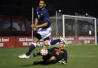 COLLEGE PARK, MD. - AUGUST 20, 2012:  Jordan Tatum (21) of  the University of Maryland makes a save against Mikey Minutillo (25) of Penn State during an NCAA match at Ludwig Field, in College Park, Maryland on August 20. The game ended in a 2-2 tie.