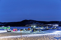 Headlamps streak during a long-exposure as mushers feed and tend to their dogs in the evening at the Iditarod checkpoint on Thursday, March 8th during the 2018 Iditarod Sled Dog Race -- Alaska<br /> <br /> Photo by Jeff Schultz/SchultzPhoto.com  (C) 2018  ALL RIGHTS RESERVED