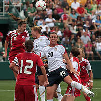 Canada's Emily Zurrer (2) and USWNT's Rachel Buehler (21) and Abby Wambach (20)go up for a header on a corner kick. The U.S. Women's National Team defeated 1-0 in a friendly match at Marina Auto Stadium in Rochester, NY on July 19, 2009. Abby Wambach of the USWNT scored her 100th career goal in the second half..