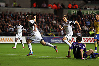 Saturday 28 September 2013<br /> Pictured: Ben Davies of Swansea (L) celebrating his goal with team mate Michu (R).<br /> Re: Barclay's Premier League, Swansea City FC v Arsenal at the Liberty Stadium, south Wales.