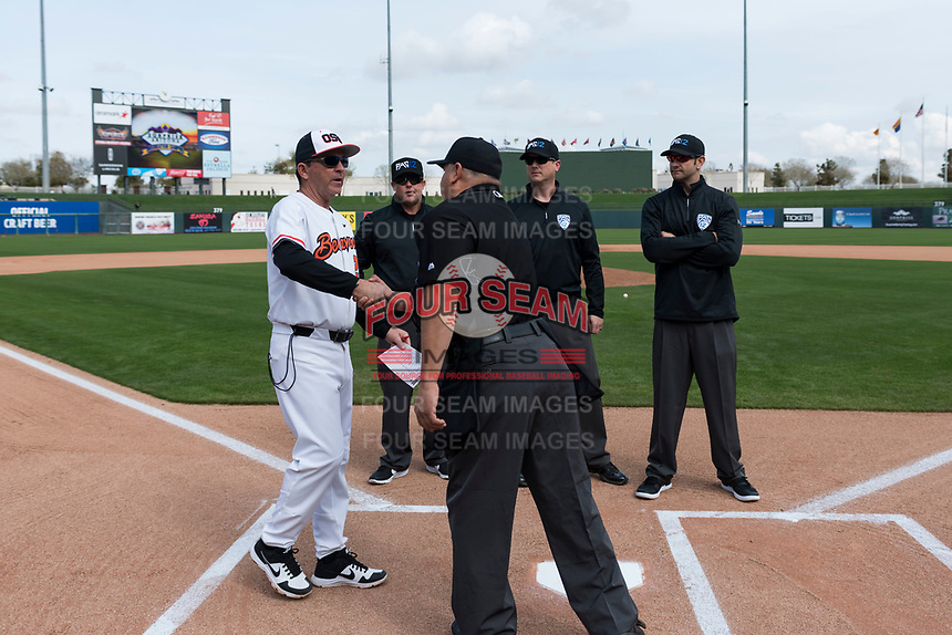 Oregon State Beavers interim head coach Pat Bailey meets the umpire crew before a game against the New Mexico Lobos on February 15, 2019 at Surprise Stadium in Surprise, Arizona. Oregon State defeated New Mexico 6-5. (Zachary Lucy/Four Seam Images)