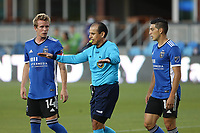 SAN JOSE, CA - MAY 12: Jackson Yueill #14 of the San Jose Earthquakes, Referee Baldomero Toledo, and Cristian Espinoza #10 of the San Jose Earthquakes during a game between Seattle Sounders FC and San Jose Earthquakes at PayPal Park on May 12, 2021 in San Jose, California.