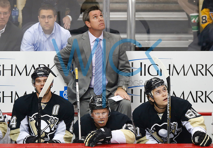 Head coach Mike Sullivan of the Pittsburgh Penguins stands behind the bench in his first game against the Washington Capitals during the game at Consol Energy Center in Pittsburgh, Pennsylvania on December 14, 2015. (Photo by Jared Wickerham / DKPS)