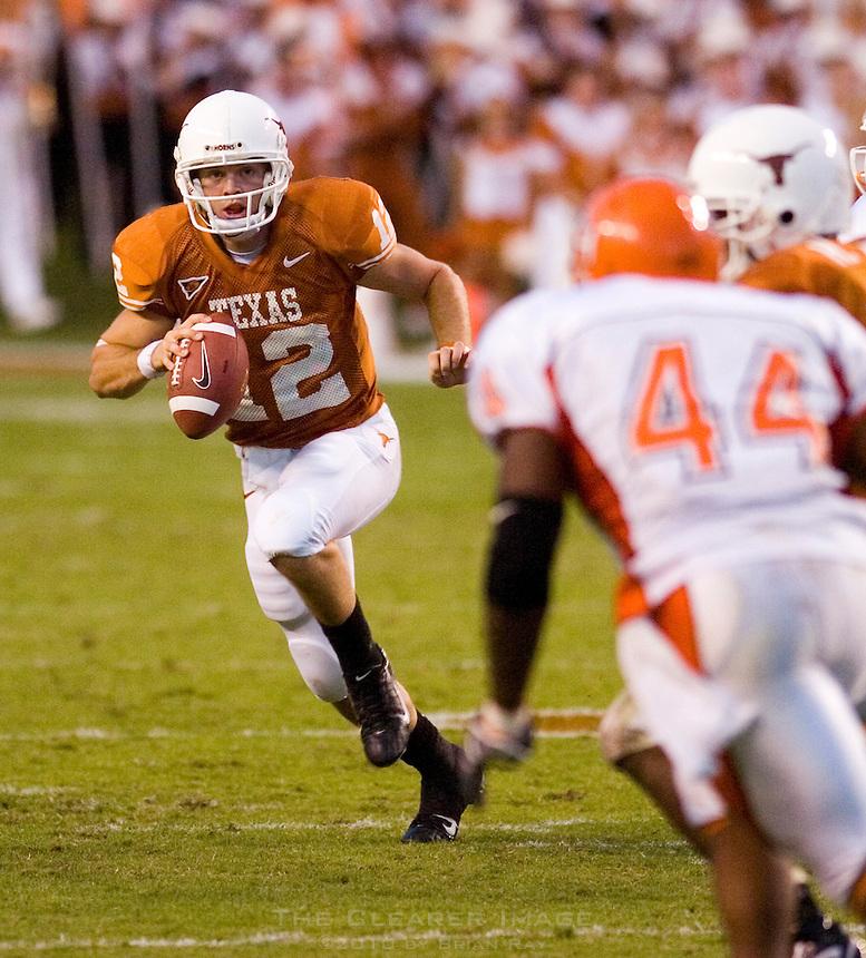 30 September 2006: Texas quarterback Colt McCoy (#12) prepares to dodge Sam Houston State defender Patrick Robinson (#44) during the Longhorns 56-3 victory over the Sam Houston State Bearkats at Darrell K Royal Memorial Stadium in Austin, TX.