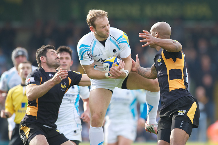 Chris Pennell of Worcester Warriors secures the high ball ahead of Andrea Masi (left) and Tom Varndell of London Wasps during the Aviva Premiership match between London Wasps and Worcester Warriors at Adams Park on Sunday 7th October 2012 (Photo by Rob Munro)